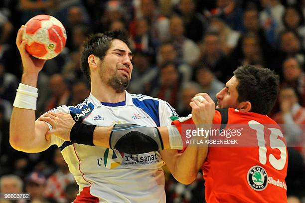 France's Nikola Karabatic vies with Iceland's Alexander Petersson on January 30 during the EHF EURO 2010 Handball Championship semifinal Iceland vs...