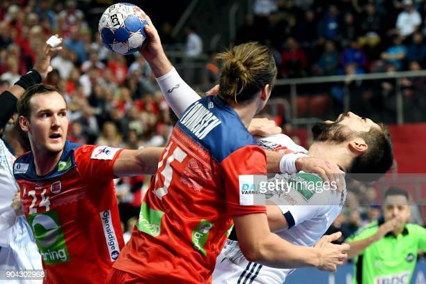 France's Nikola Karabatic vies with Norway's Christian O'Sullivan and Kent Robin Tonnesen during the preliminary round group B match of the Men's...
