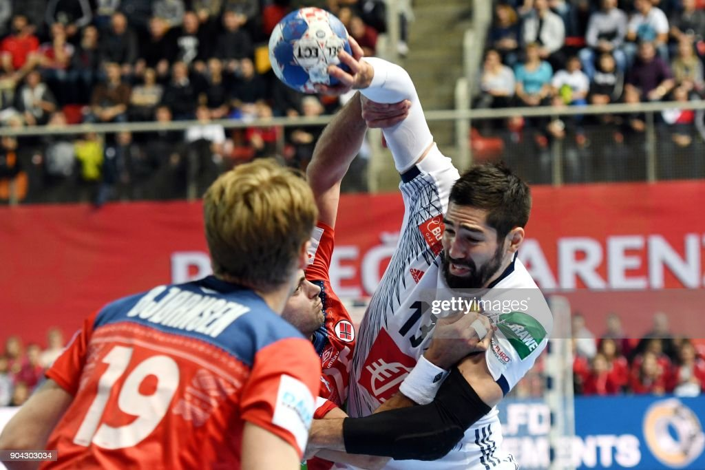 France's Nikola Karabatic (R) vies with Norway's Eivind Tangen (L) and Kristian Bjornsen during the preliminary round group B match of the Men's 2018 EHF European Handball Championship between France and Norway in Porec, Croatia on January 12, 2018. /