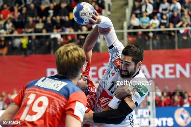France's Nikola Karabatic vies with Norway's Eivind Tangen and Kristian Bjornsen during the preliminary round group B match of the Men's 2018 EHF...
