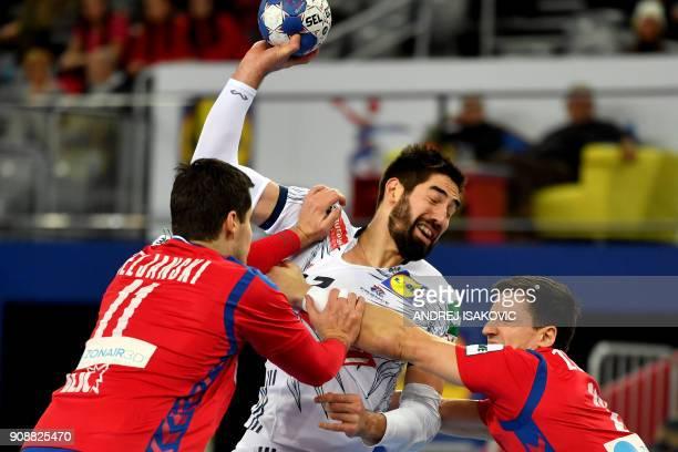 TOPSHOT France's Nikola Karabatic vies with Serbia's Bojan Beljanski and Nemanja Zelenovic during their group I match of the Men's 2018 EHF European...