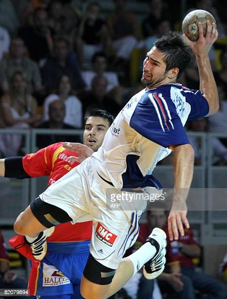 France's Nikola Karabatic vies with Spain's Carlos Ruesga during their Euro Tournament handball match, on July 27, 2008 in Strasbourg, eastern...