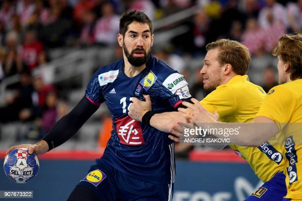 TOPSHOT France's Nikola Karabatic vies with Sweden's Max Darj and Jesper Nielsen during the group I match of the Men's 2018 EHF European Handball...