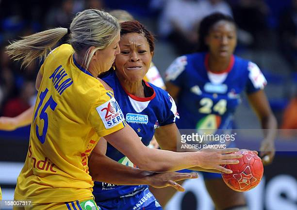 France's Nina Kamto Njitam vies with Sweden's Johanna Ahlm during their Women's EHF Euro 2012 Handball Championship match Sweden vs France on...