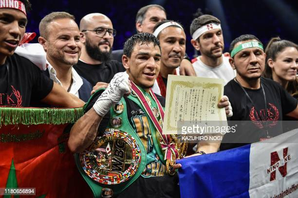 France's Nordine Oubaali celebrates after winning over Japan's Takuma Inoue after their WBC bantamweight title boxing match at Saitama Super Arena in...