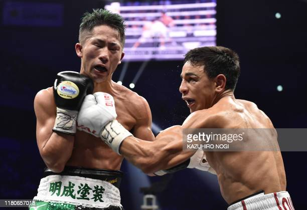 France's Nordine Oubaali fights with of Japan's Takuma Inoue during their WBC bantamweight title boxing match at Saitama Super Arena in Saitama on...