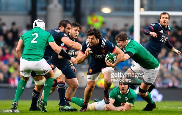 France's number 8 Kevin Gourdon runs with the ball at Ireland's hooker Rory Best during the Six Nations international rugby union match between...