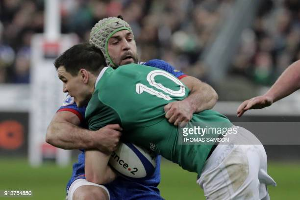 TOPSHOT France's number 8 Kevin Gourdon vies with Ireland's flyhalf Jonathan Sexton during the Six Nations rugby union match between France and...