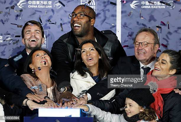 France's Olympic and World judo champion Teddy Riner, Paris mayor Anne Hidalgo and President of the Champs-Elysees Committee, Jean-Noel Reinhardt...