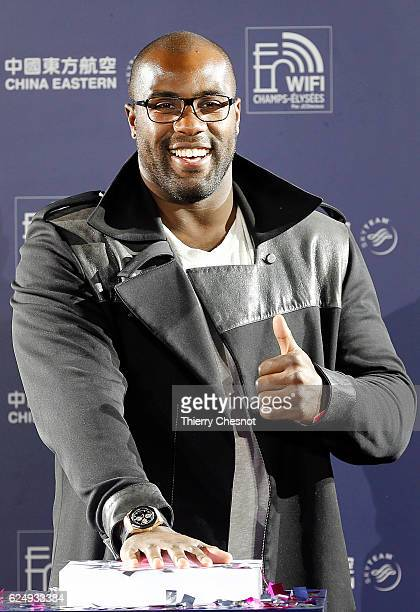 France's Olympic and World judo champion Teddy Riner poses as he officially switches on the Champs Elysees Christmas lights on November 21, 2016 in...