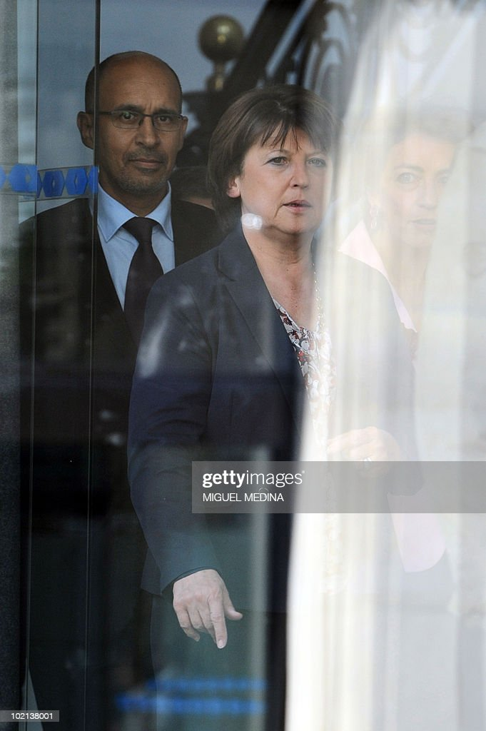 France's opposition Socialist Party (PS) leader Martine Aubry (C) flanked by French socialist MP and Socialist Party's national secretary in charge of pension Marisol Touraine (R) and PS national secretary for coordination Harlem Desir arrive together on June 16, 2010 at the Socialist Party headquarters in Paris for a press conference focused on the government pension reform. The French government unveiled plans on Wednesday to raise the retirement age from 60 to 62 in a sweeping overhaul of the pensions system that several political parties and labour unions immediately vowed to fight.