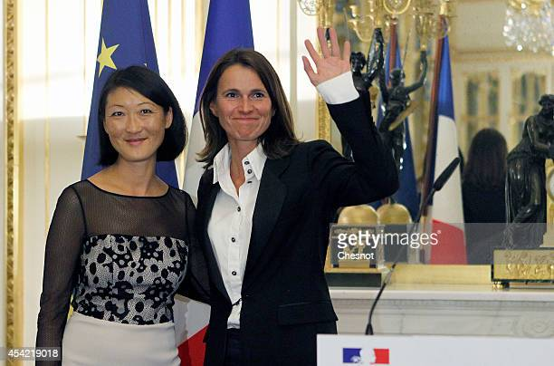 France's outgoing Culture Minister Aurelie Filippetti and newly named Culture Minister Fleur Pellerin during a handover ceremony on August 26 in...