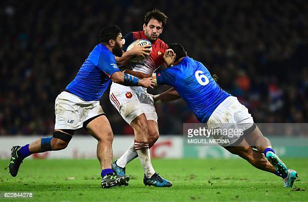 France's outside center Remi Lamerat vies with Samoa's hooker Manu Leiataua and Samoa's blindside flanker Alafoti Faosiliva during the friendly rugby...