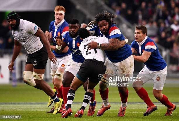TOPSHOT France's outside centre Mathieu Bastareaud vies with Fiji's Henry Seniloli during the international rugby union test match between France and...
