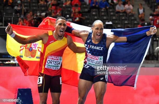 France's Pascal Martinot-Lagarde and Spain's Orlando Ortega celebrate with their national flags after the men's 110m Hurdles final race during the...