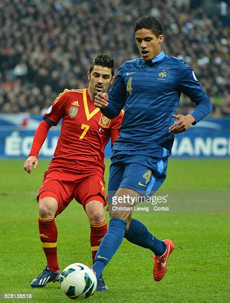 France's Patrice Evra and Pedro during the FIFA 2014 World Cup qualifying round group I soccer match, France Vs Spain at Stade de France in...
