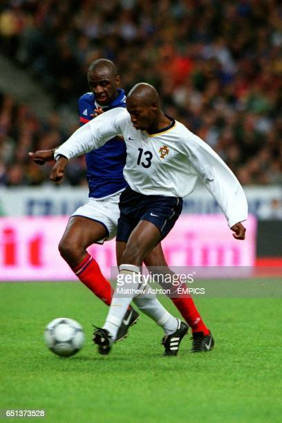 France's Patrick Vieira arrives too late to prevent Portugal's Luis Boa Morte passing the ball forward