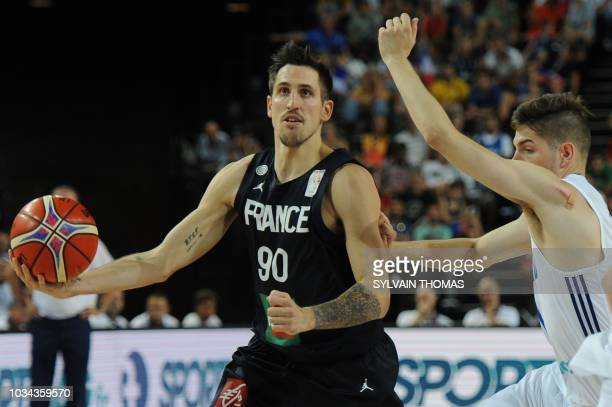 France's Paul Lacombe fights for the ball with Finland's Topias Palmi during the 2019 FIBA Basketball World Championship European qualifying group...