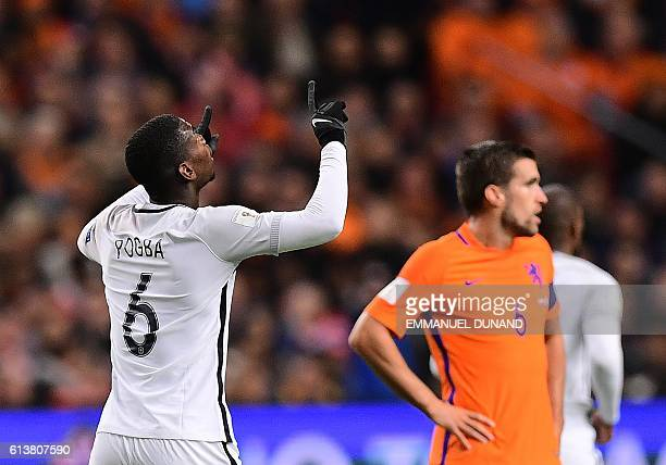 France's Paul Pogba celebrates after scoring a goal during the FIFA World Cup 2018 qualifying football match Netherlands vs France on October 10 2016...