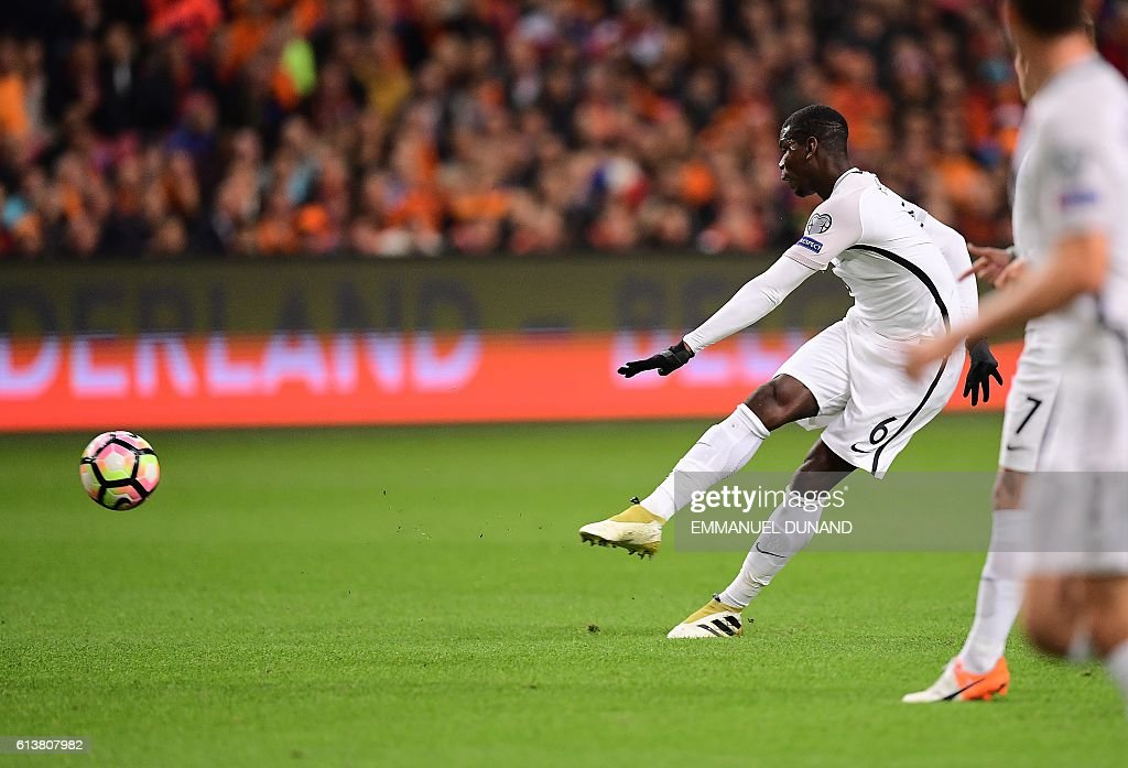 TOPSHOT - France's Paul Pogba shoots to score a goal during the FIFA World Cup 2018 qualifying football match Netherlands vs France on October 10, 2016 at the Amsterdam Arena in Amsterdam. / AFP / EMMANUEL