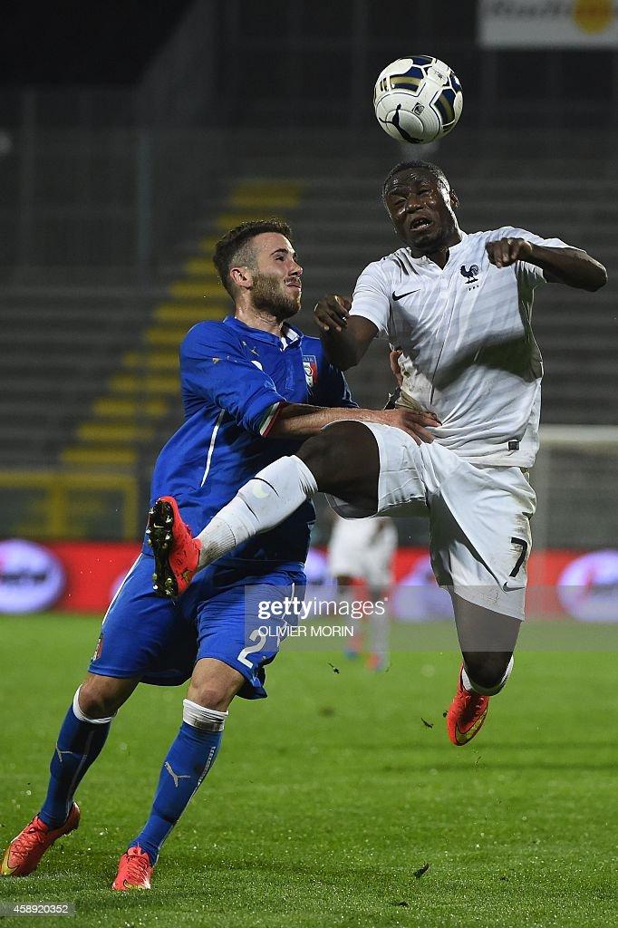 France's Paul-Georges Ntep (R) vies with Italy's Francesco Zampano during the friendy football match Italy U2O vs France U21, on November 13, 2014, at Alberto Picco stadium in La Spezia.