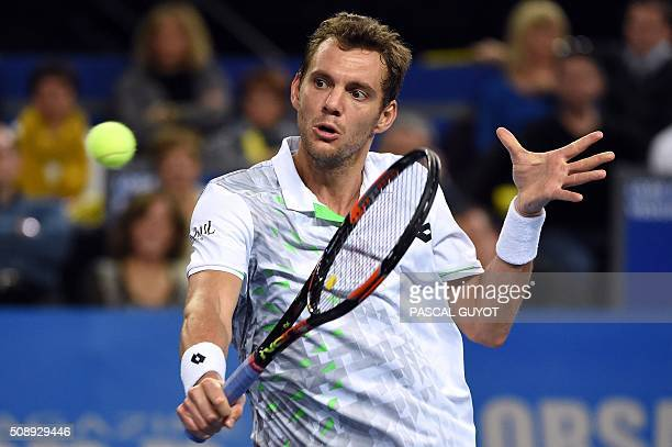 France's PaulHenri Mathieu returns the ball to France's Richard Gasquet during the final tennis match at the ATP World Tour Open Sud de France in...