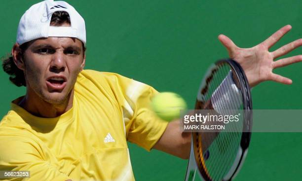 France's PaulHenry Mathieu plays a backhand during an Australian Open tennis tournament second round match against Alex Bogomolov Jr of the US in...