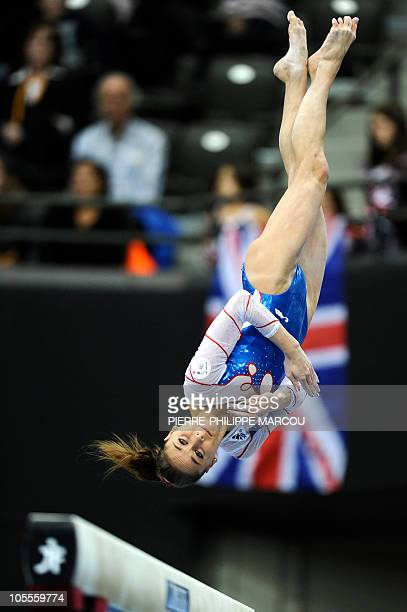 France's Pauline Morel performs her routine on the balance beam near a Britain's flag in the Women's qualifying session at the 42nd Artistic...
