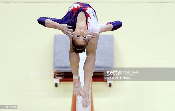 France's Pauline Morel performs in the balance beam event during the Artistic Gymnastics World Championships 2009 at the 02 Arena in east London on...