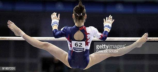 France's Pauline Morel performs in the uneven bars event during the Artistic Gymnastics World Championships 2009 at the 02 Arena in east London on...