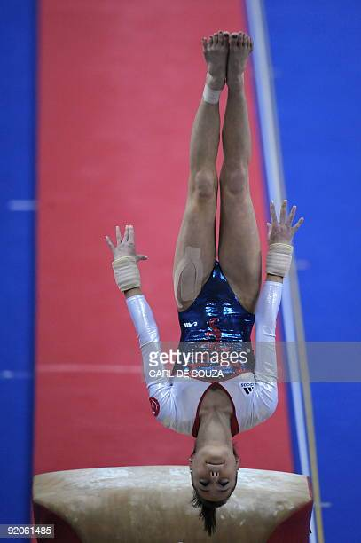 France's Pauline Morel performs in the vault event in the women's individual allaround final during the Artistic Gymnastics World Championships 2009...