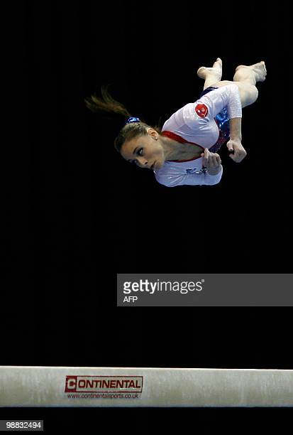 France's Pauline Morel performs on the beam during the women seniors team final in the European Artistic Gymnastics Championships 2010 at the...