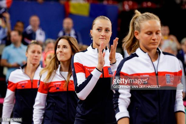 France's Pauline Parmentier Alize Cornet Kristina Mladenovic and Fiona Ferro applaud the crowd ahead of play on the second day of the Fed Cup tennis...