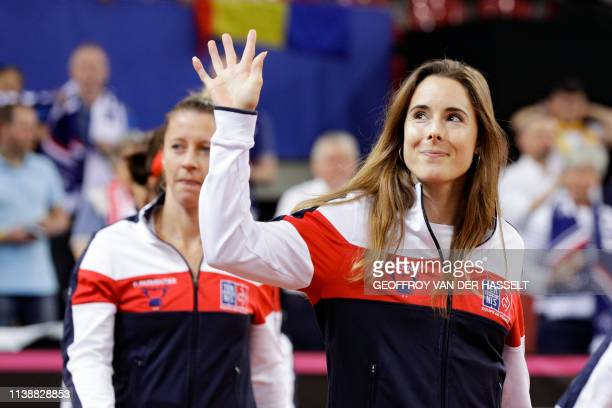 France's Pauline Parmentier and Alize Cornet acknowledge the crowd ahead of play on the second day of the Fed Cup tennis semifinal match between...