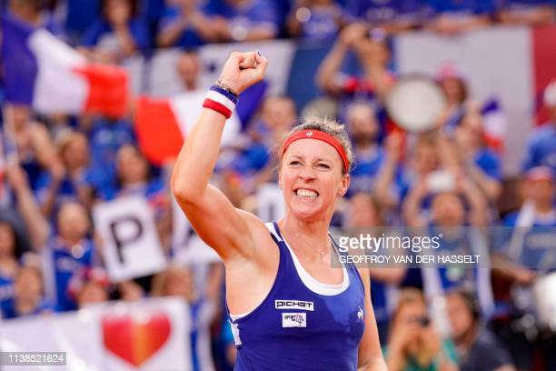 France's Pauline Parmentier reacts after winning against Romania's IrinaCamelia Begu in the fourth rubber of the Fed Cup tennis semifinal match...