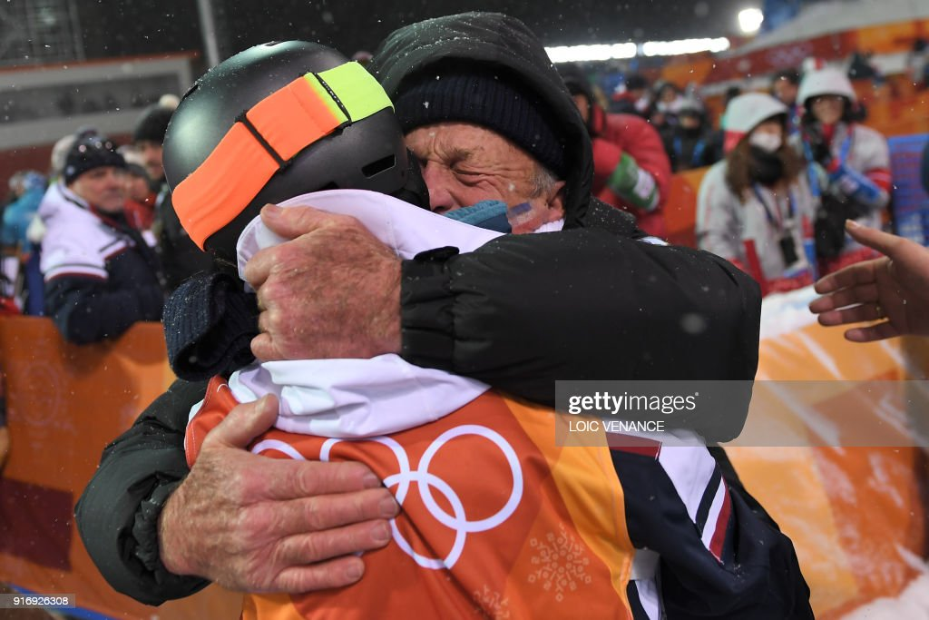 TOPSHOT - France's Perrine Laffont is congratulated after the women's moguls final event during the Pyeongchang 2018 Winter Olympic Games at the Phoenix Park in Pyeongchang on February 11, 2018. /