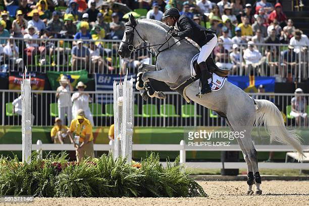 France's Philippe Rozier riding Rahotep de Toscane takes part in the jumping competition at the Olympic Equestrian Centre during the Rio 2016 Olympic...