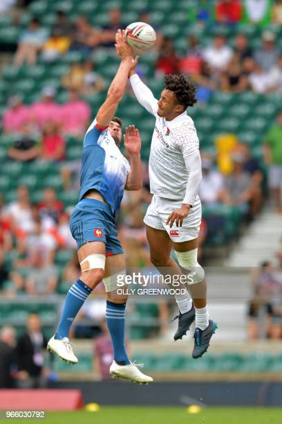 France's Pierre Boudehent jumps for the ball with England's Ryan Olowofela during the pool C match between England and France on the first day of the...
