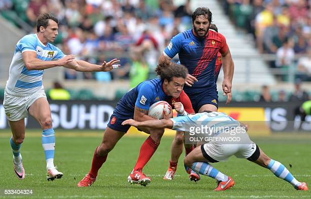 France's Pierre Gilles Lakafia is tackled by Argentina's Gaston Revol during the plate semi final of the World Rugby Sevens Series London rugby union...