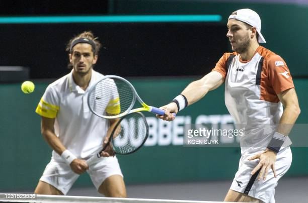 France's Pierre Hugues Herbert and Germany's Jan Lennard Struff return the ball during their doubles match against Croatia's Nicola Mektic and team...