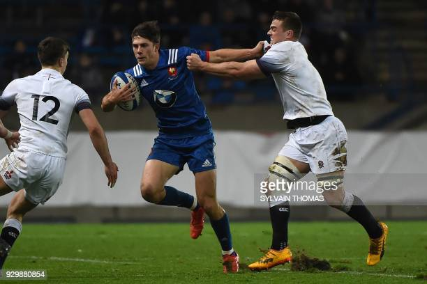 France's Pierre Louis Barassi vies with England's Ben Earl during the Six Nations U20 rugby union match between France and England on March 9 2018 at...