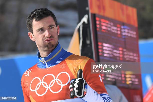France's Pierre Vaultier celebrates after the men's snowboard cross big final at the Phoenix Park during the Pyeongchang 2018 Winter Olympic Games on...