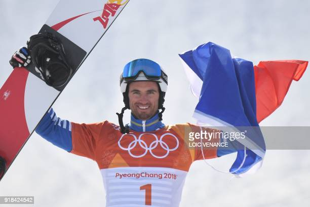 France's Pierre Vaultier celebrates on the podium after the men's snowboard cross big final at the Phoenix Park during the Pyeongchang 2018 Winter...