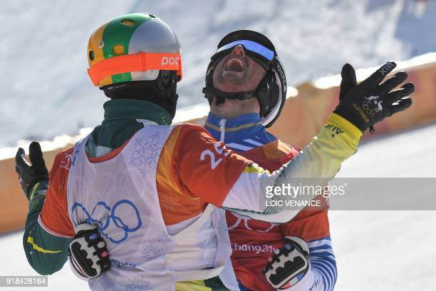 TOPSHOT France's Pierre Vaultier celebrates with Australia's Jarryd Hughes after the men's snowboard cross big final at the Phoenix Park during the...