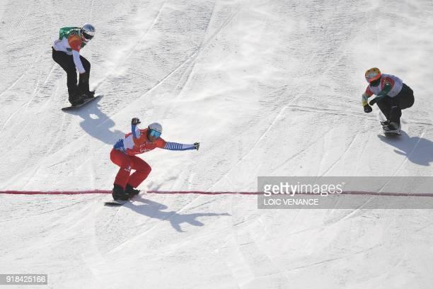 France's Pierre Vaultier crosses the finish line ahead of Australia's Jarryd Hughes and Spain's Regino Hernandez during the men's snowboard cross big...