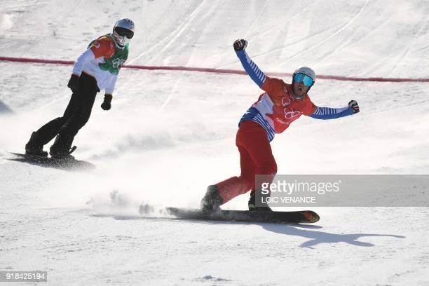 France's Pierre Vaultier crosses the finish line ahead Spain's Regino Hernandez during the men's snowboard cross big final at the Phoenix Park during...