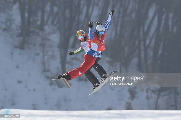 TOPSHOT France's Pierre Vaultier leads ahead of Australia's Jarryd Hughes during the men's snowboard cross big final at the Phoenix Park during the...
