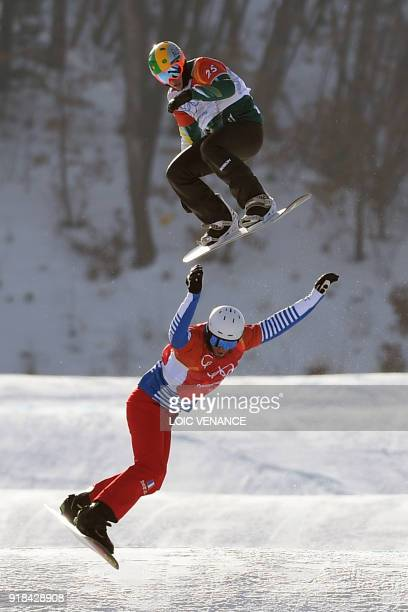 France's Pierre Vaultier leads ahead of Australia's Jarryd Hughes during the men's snowboard cross big final at the Phoenix Park during the...