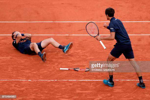 France's Pierre-Hugues Herbert and compatriot Nicolas Mahut celebrate after victory over Austria's Oliver Marach and Croatia's Mate Pavic, at the end...
