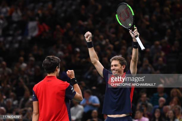 France's Pierre-Hugues Herbert and France's Nicolas Mahut celebrate after winning against Russia's Karen Khachanov and Russia's Andrey Rublev during...